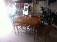 Golden Pine Table with 4 Chairs  and glass table top - in good condition. OAKVILLE