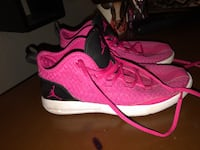 pair of pink-and-black Nike running shoes Medford, 97501