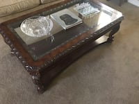 rectangular brown wooden framed glass top coffee table Eastvale, 92880