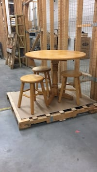 round brown wooden table with two chairs Winnipeg, R3H 0G4