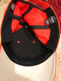 red and black fitted cap