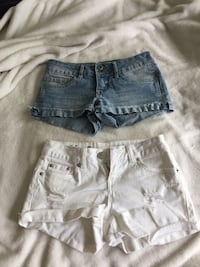 two grey and white denim short shorts