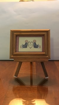 Brown wooden photo framed table decor.