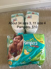 two Pampers Swaddlers disposable diaper packs 47 km