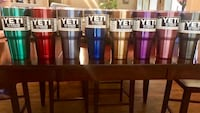 assorted-color Yeti tumblers