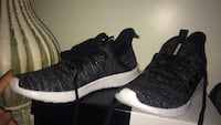 pair of black-and-white Adidas running shoes Oregon, 43616