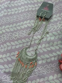 silver-colored necklace with pendant
