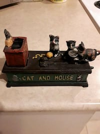 CAST IRON COIN BANK.