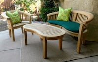 oval brown wooden table with four chairs dining set San Diego