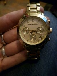 round gold-colored Rolex chronograph watch with link bracelet 3153 km