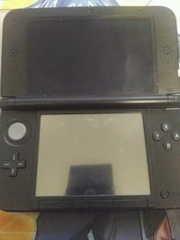 black Nintendo DS with game cartridge Surrey, V3R 6S9