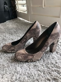 pair of brown-and-black snakeskin leather pumps