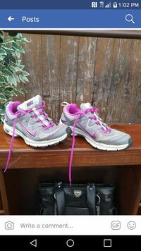 pair of pink-and-grey Nike running shoes screensho