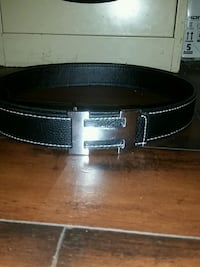 black Hermes leather belt with silver buckle