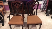 two brown wooden framed pink padded chairs Edmonton, T5K 1H6