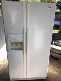 white side-by-side refrigerator with dispenser 1147 mi