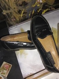 pair of black leather loafers 672 mi