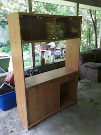 Entertainment center with glass doors