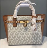 gray, white, and brown monogrammed Michael Kors leather shoulder bag