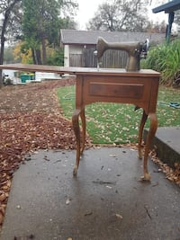 brown wooden wholetable sewing machine