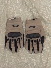 pair of gray-and-black Oakley motorcycle gloves