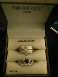 3 Sterling silver rings one with red gemstone 41 km