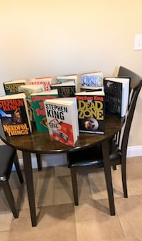 Collection of Stephen King hardcover books and several paperbacks