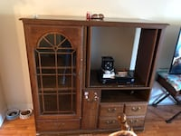 brown wooden entertainment center , tile table and 6 chairs all in excellent condition one chairs does have marks on it due to puppy , chairs are very sturdy, I am selling due to moving and can't take it with me .  Crestview, 32536