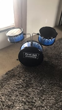 blue and black First Act discovery drum kit