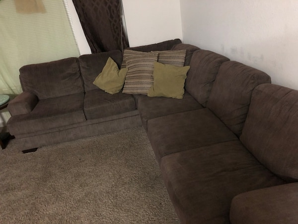 Used Brown Suede Sectional Sofa With Throw Pillows And Two End Brown