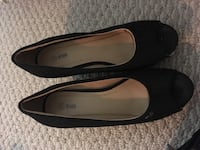 pair of black leather flats 23 km