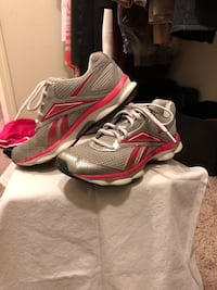 pair of gray-and-red Reebok running shoes