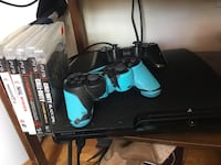 Sony PlayStation 3 Slim and two cases Kingston, K7M 2Y8