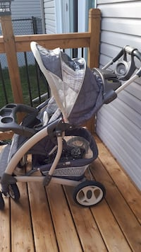 baby's gray and white stroller