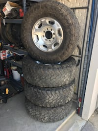 silver eight studs auto rims with tires