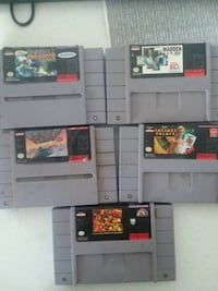 black Nintendo game console with game cartridges Payson