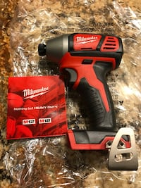 red and black Milwaukee air impact wrench