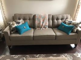 Couch and chair with multi colored pillows for sale!