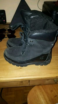 pair of black leather boots Toronto, M9N 1Z8