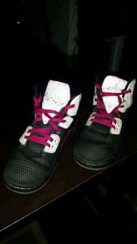 pair of black-and-pink Nike running shoes Rochester, 55901