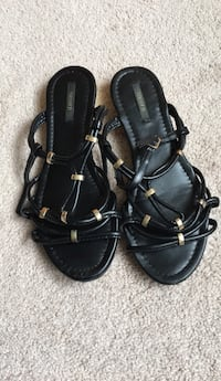 Pair of black leather open toe ankle strap sandals Woodbury, 55125