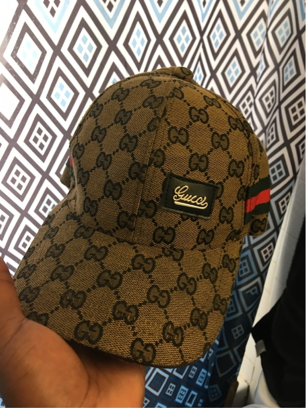 brown and black monogrammed Gucci cap