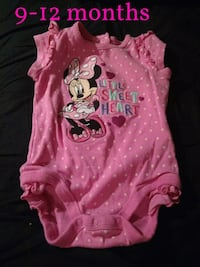 girl's pink Minnie mouse onesie