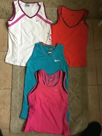 four assorted-color of tank tops