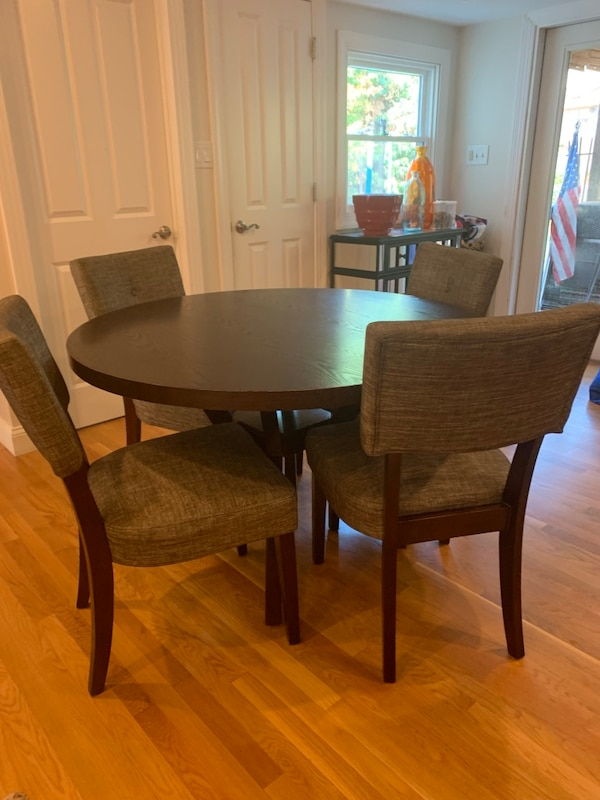 48 inch round table and 6 chairs, table is 30 1/2 inches high and chairs are 37 inches high.