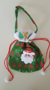 Green white and red santa claus bag