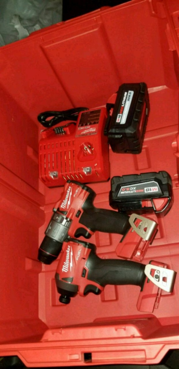 Milwaukee cordless hand drill with battery charger