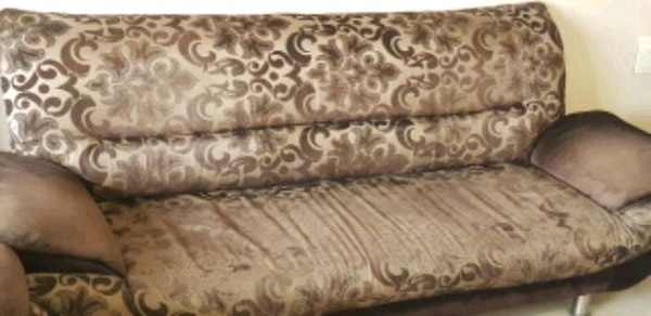 brown and beige floral sofa