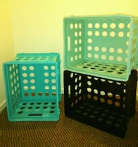 three black and white plastic containers