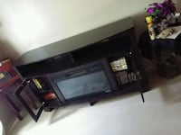 black wooden TV stand with flat screen television Knoxville, 37931